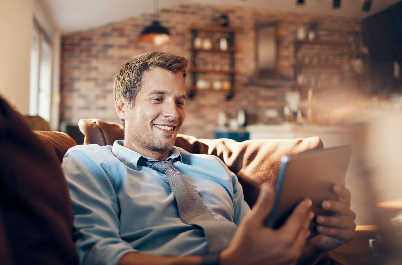 Young man using tablet in living room